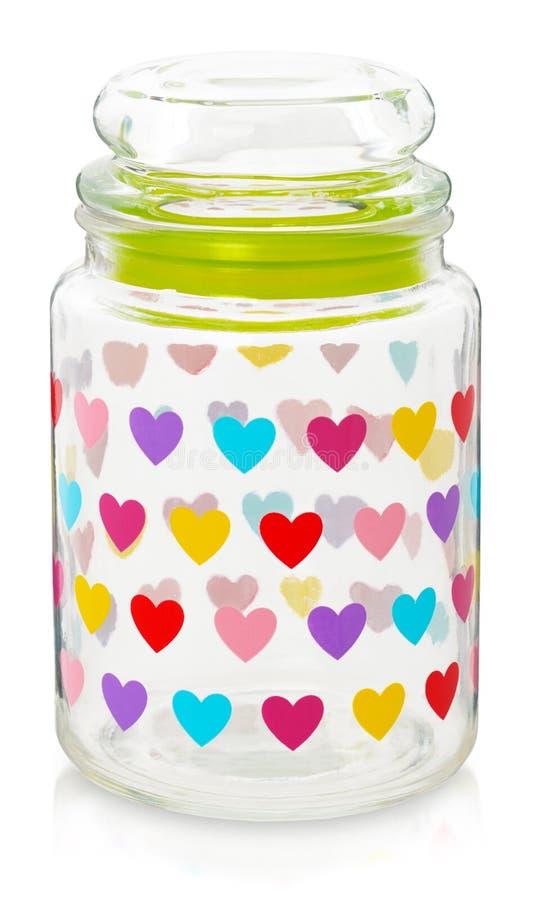 Szklany słój z barwionymi sercami Pojemność dla przechować odizolowywam dalej zdjęcia royalty free