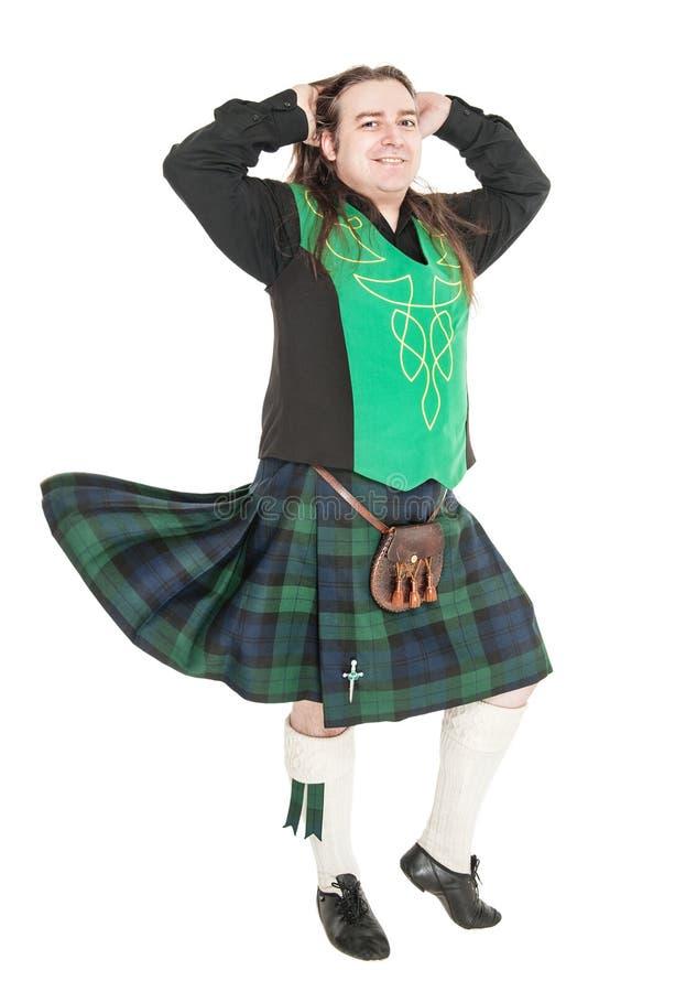 Szkocki mężczyzna w tradycyjnym krajowym kostiumu z podmuchowym kilt zdjęcia royalty free