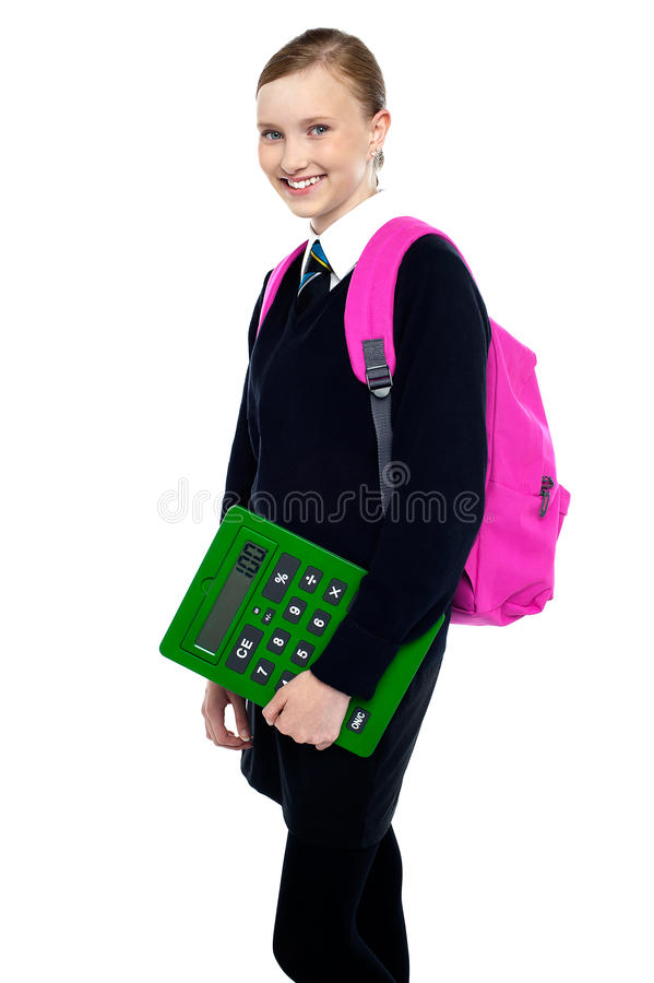Szkolna dziewczyna target1354_0_ z plecakiem i kalkulatorem obrazy stock