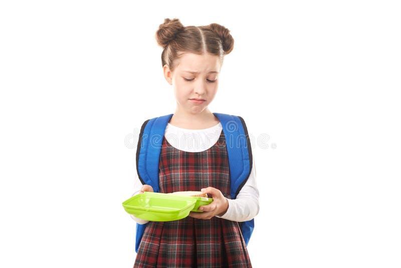 Szkolna dziewczyna z lunchbox obraz royalty free