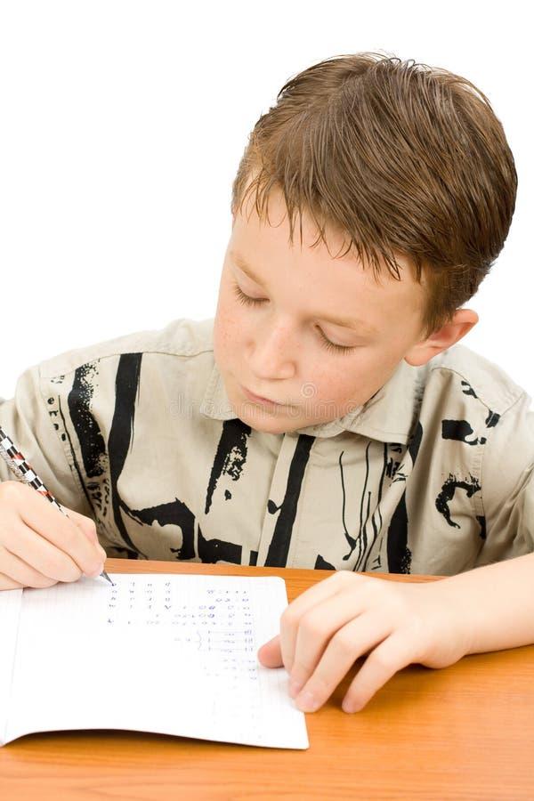szkolny chłopiec writing obraz royalty free