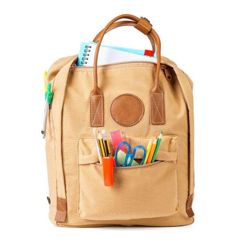 Szkolny plecak pełno różnorodny materiały odosobniony obraz royalty free