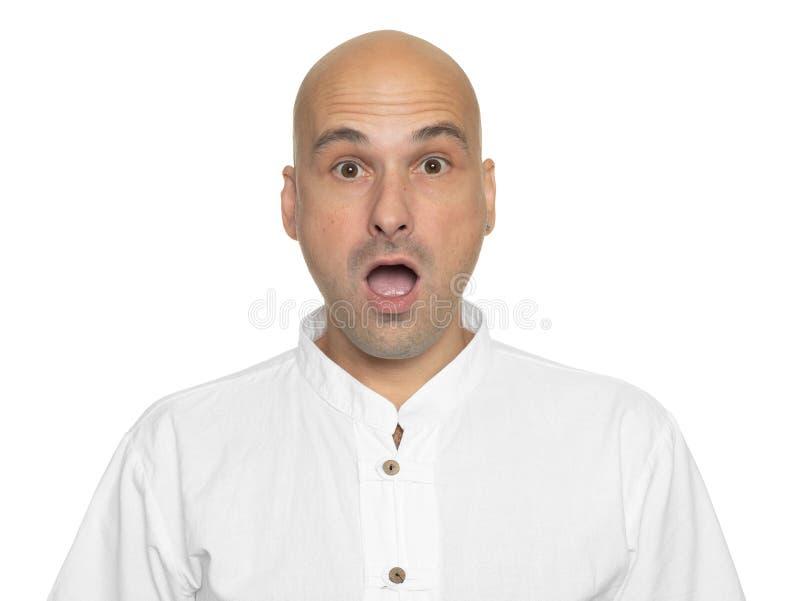 Szokujący łysy mężczyzna otwierał jego usta z niespodzianką zdjęcie royalty free