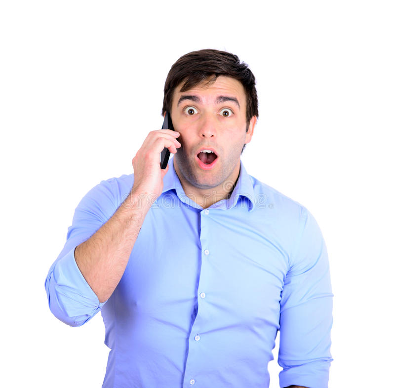 Szokujący biznesmen opowiada na telefonie obrazy stock