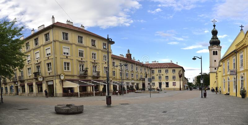 Late afternoon with spring clouds above old city square in Szombathely, Hungary royalty free stock photography