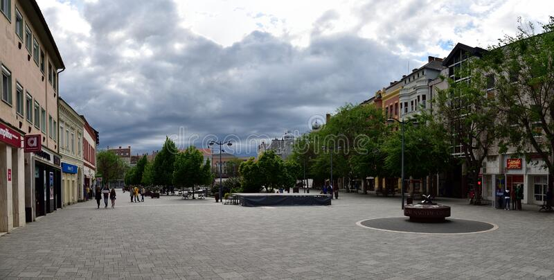 Late afternoon with stormy clouds above Old city square in Szombathely, Hungary. SZOMBATHELY / HUNGARY, APRIL 27, 2019. Late afternoon with stormy clouds above royalty free stock photo