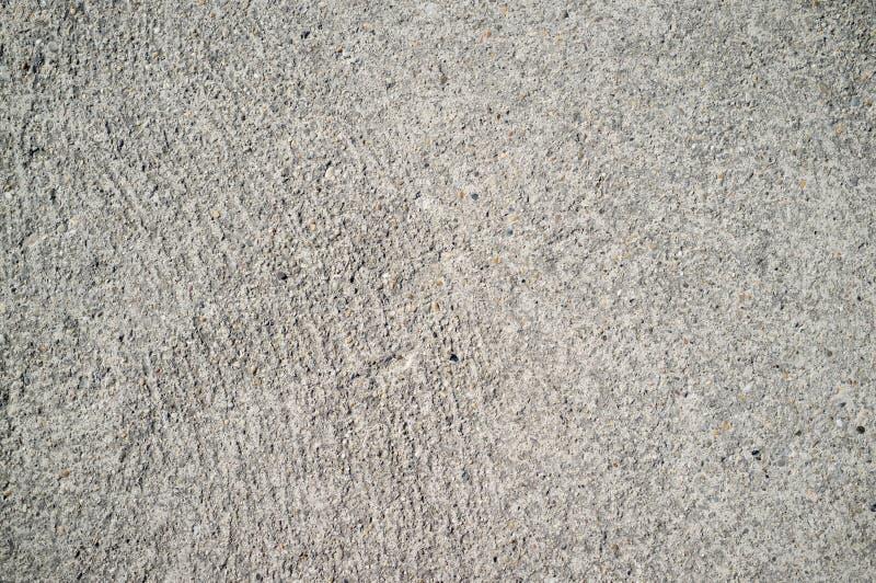 Szorstka betonowej ?ciany tekstura z ma?ymi, popielatymi ska?ami osadza? w powierzchni, obraz royalty free