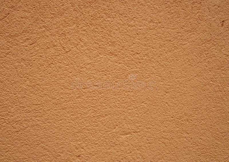 Szorstka textured lekka beżowa pomarańcze textured krupiastego szorstkiego ściany powierzchni tło fotografia stock
