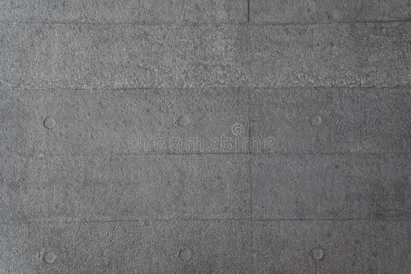 Szorstki betonowy blok z stemplową foremką w cegła wzorze, tło teksturze, betonowej budowie/architektonicznej materiału, szarość/ zdjęcia royalty free