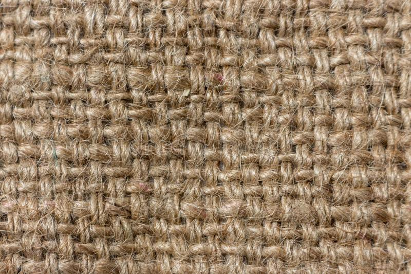 Szorstki dziewiarski tło Prostacki textured płótno zdjęcie stock