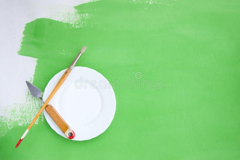 Szorstki tło z obrazów instrumentami i talerzem obraz royalty free