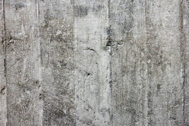 Szorstkiej powierzchni popielaty monolitowy beton jako tekstury zakończenie zdjęcia royalty free