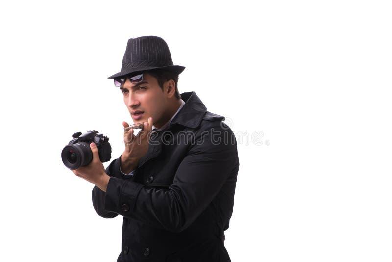 Szpieg z kamerą bierze obrazki odizolowywających na bielu obrazy stock