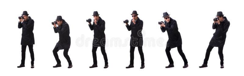 Szpieg z kamerą bierze obrazki odizolowywających na bielu zdjęcia stock
