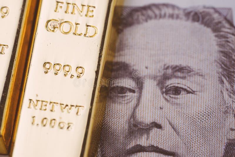 Sztaba, złoto lub ingot na Japońskiego jenu banknocie, używać jako bogactwo, inwestycja i bezpieczną przystanią na kryzysie finan zdjęcie royalty free