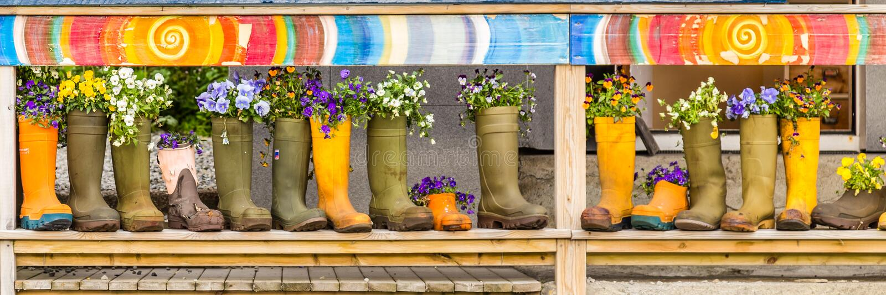 Sztandar z rzędu rainboots obrazy stock