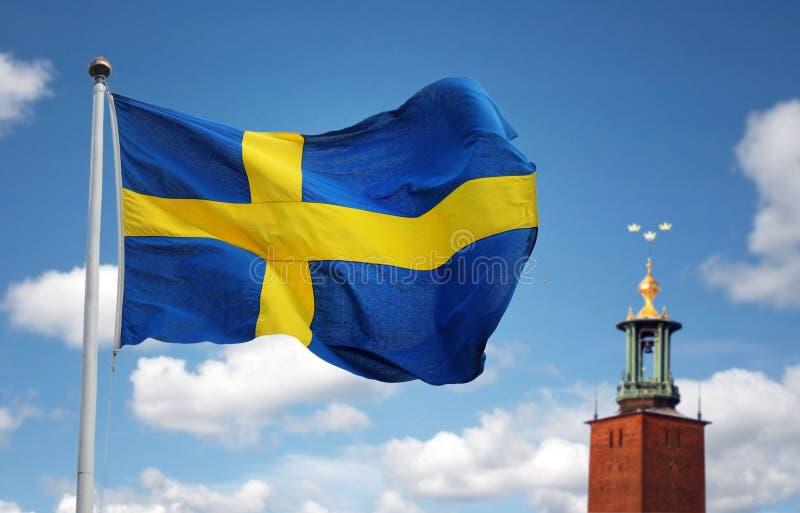 Sztokholm miasto i Szwedzka flaga fotografia royalty free