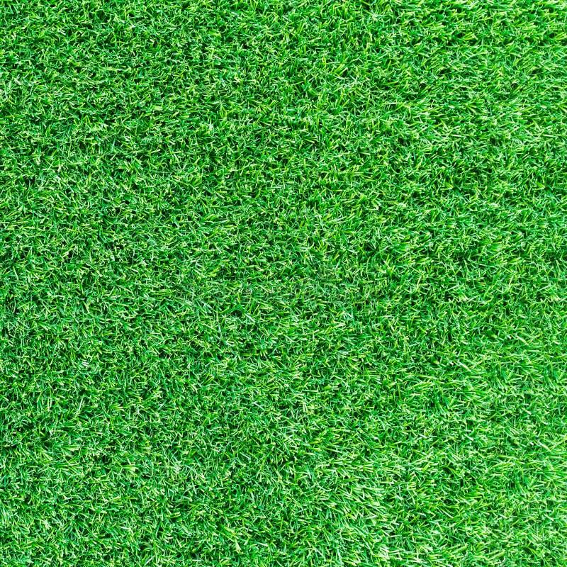 Sztuczna zielonej trawy tekstura lub zielonej trawy tło dla pola golfowego boisko do piłki nożnej lub sportów tło zdjęcie stock