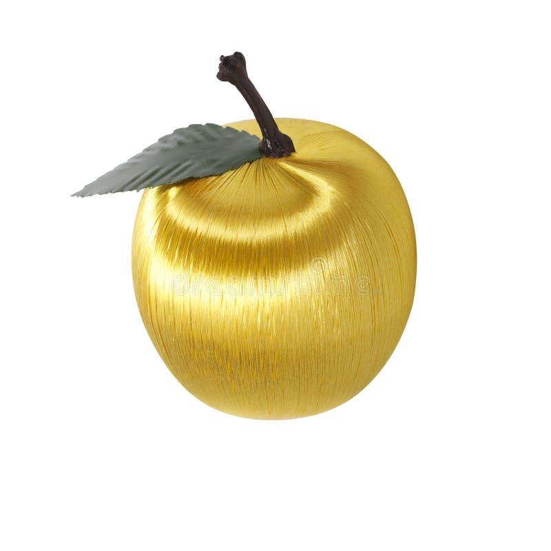 Sztuczny złocisty jabłko z liściem odizolowywającym na bielu zdjęcia stock