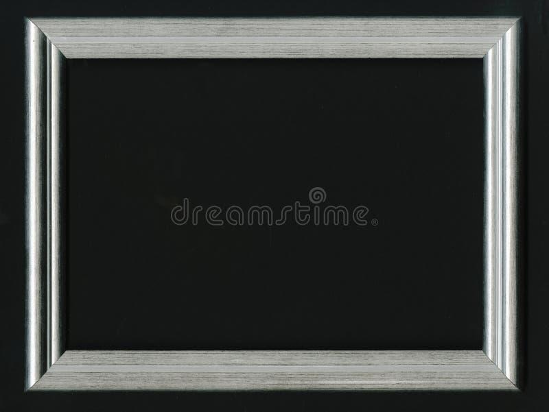 Sztuki wystawy pojęcie Srebna fotografii rama Stawia twój swój obrazek inside Na czarnym tle zdjęcie royalty free