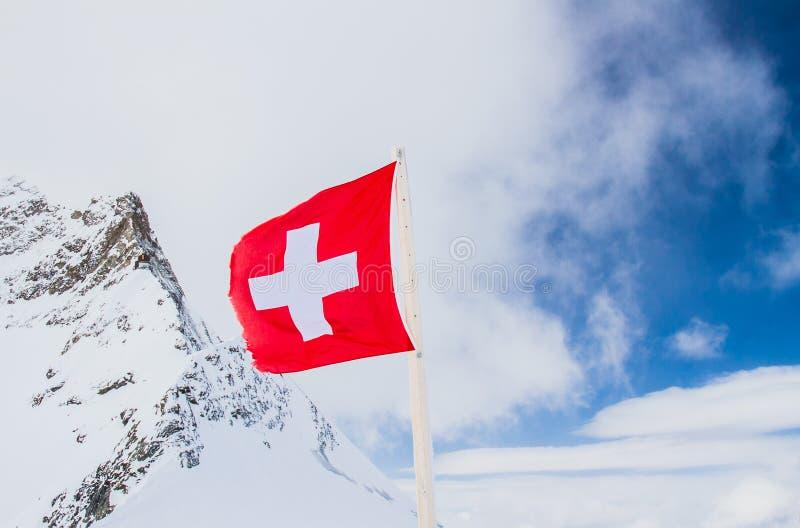 Szwajcar flaga przy wierzchołkiem fotografia stock