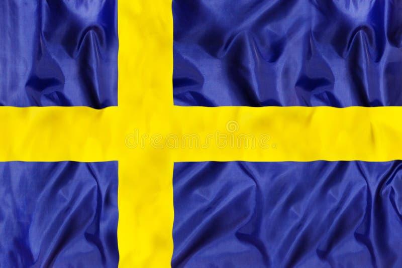 Szwecja flaga państowowa z falowanie tkaniną fotografia stock