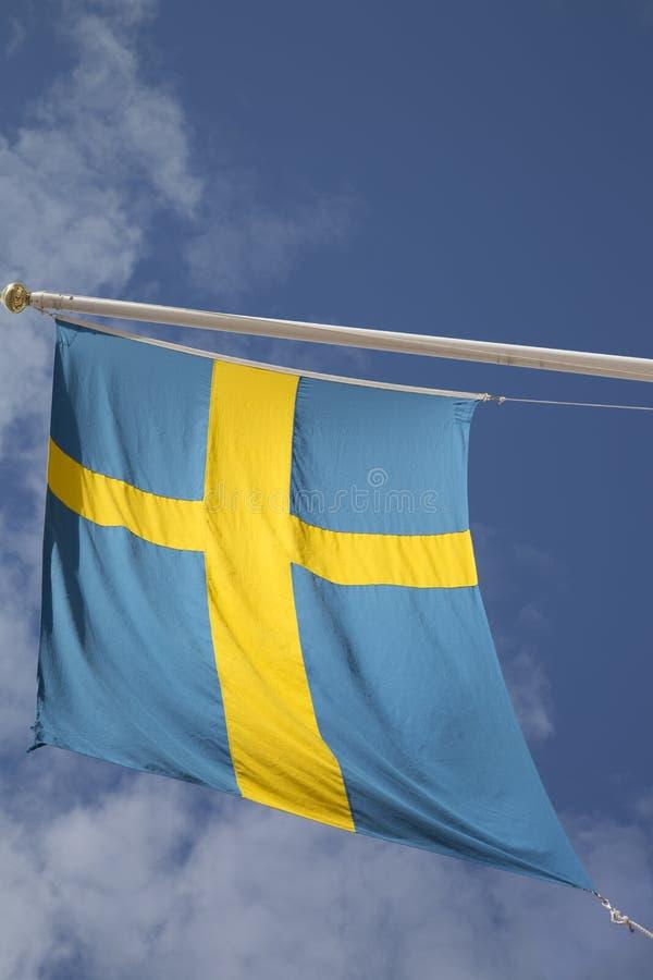 Szwedzi flaga na niebieskim niebie obrazy royalty free