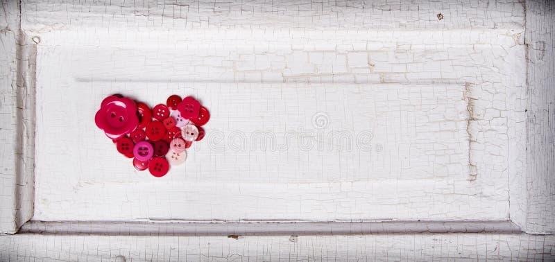 Szyć guziki w formie serca royalty ilustracja