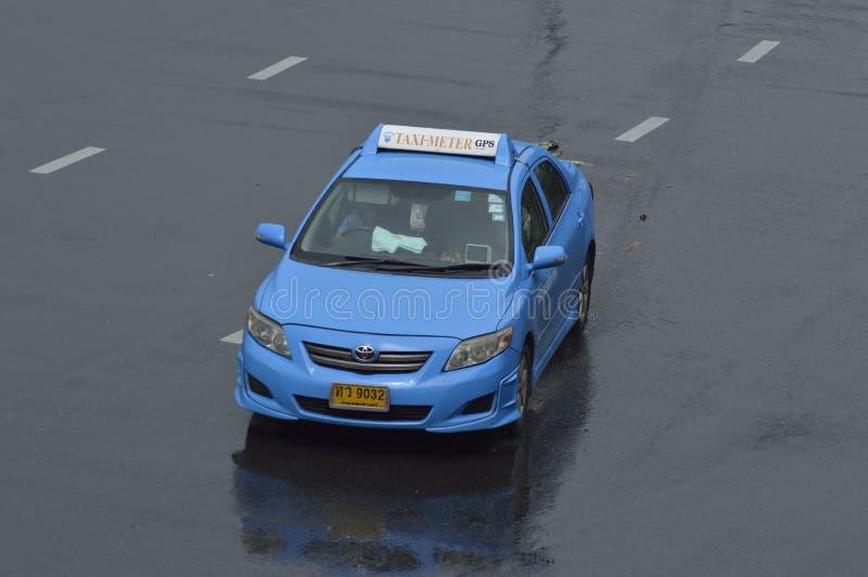 Táxi azul de Toyota Corolla Tailândia foto de stock