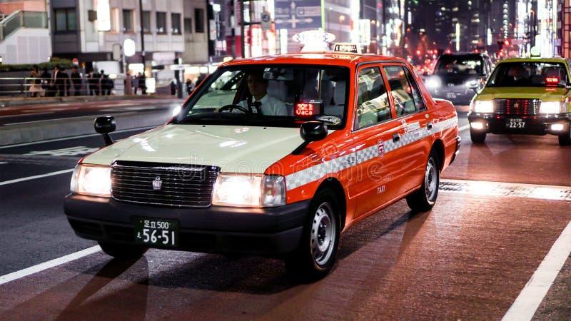 Táxi de Japão na noite imagem de stock royalty free