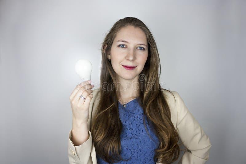Tänd ljus kula för kvinna innehav royaltyfri fotografi