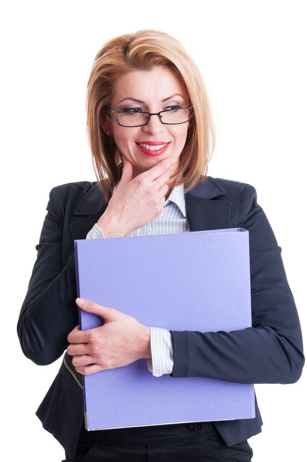 Tänkande affärskvinna som ler och arkivbilder