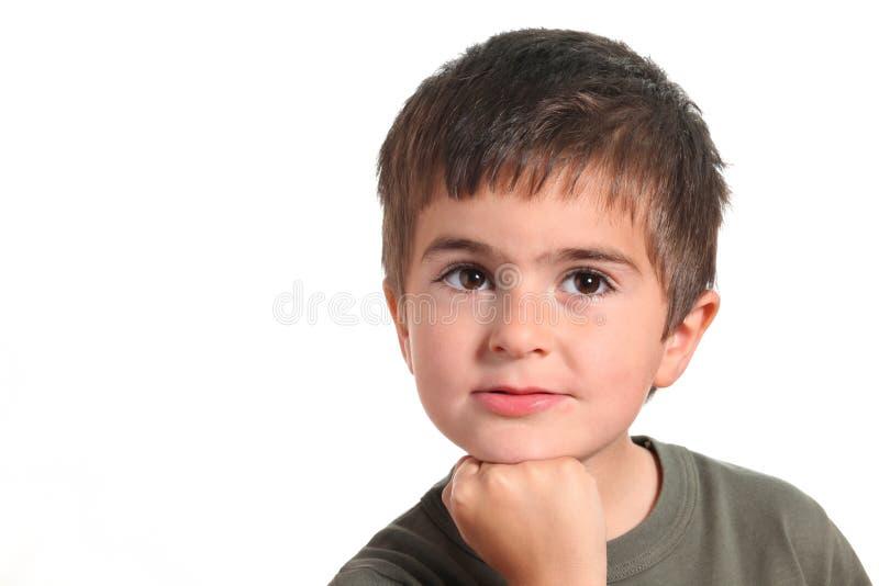 tänkande barn för pojkestående royaltyfria foton