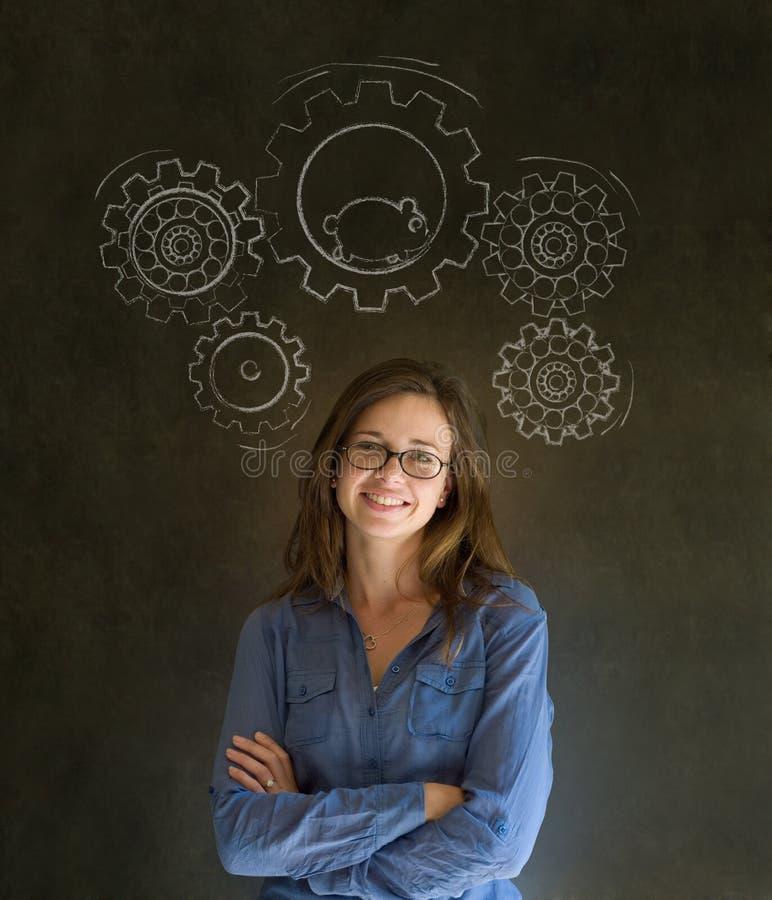 Den tänkande affärskvinnan med utrustar kuggar och hamsteren royaltyfri bild