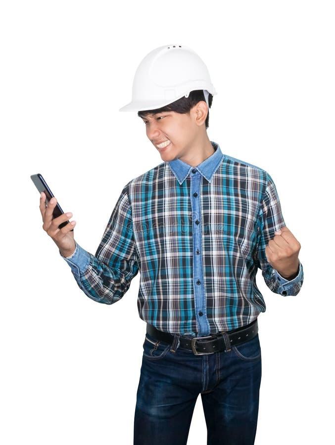T?nkande kommando f?r aff?rsmantekniker med mobiltelefonen med ett n?tverk 5g, snabb mobil internet och b?r den vita s?kerhetshj? arkivfoton