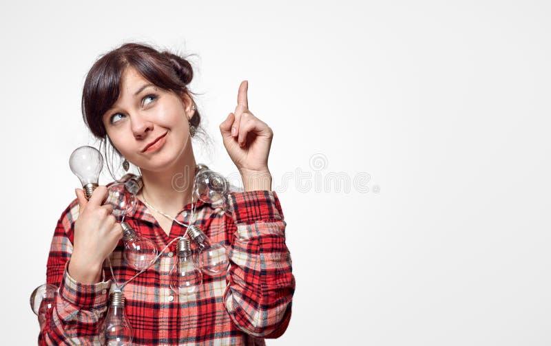 Tänkande snilleidé för ung härlig flicka fotografering för bildbyråer