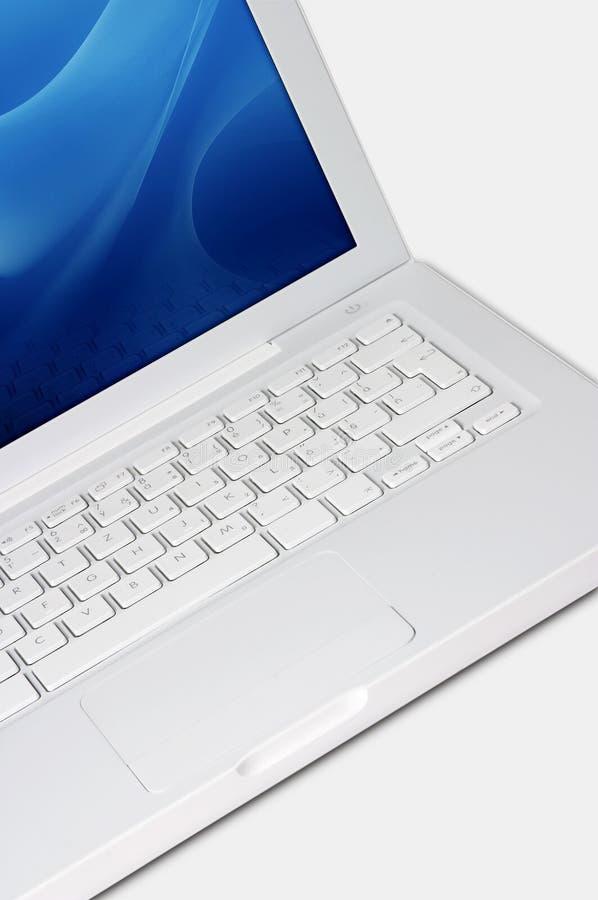 tät bärbar dator upp white royaltyfri bild