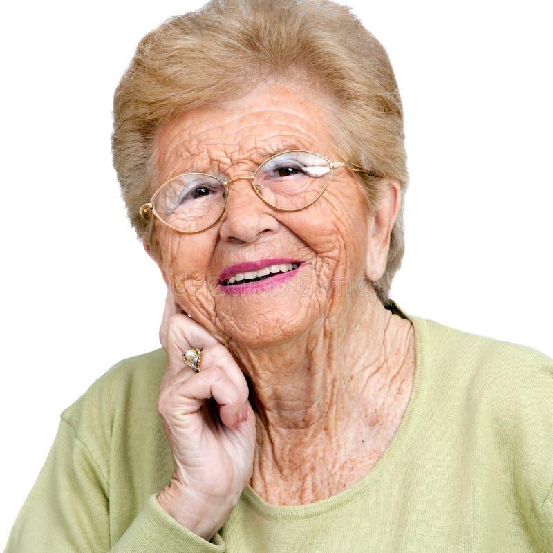 tät ståendepensionär upp kvinna royaltyfri foto