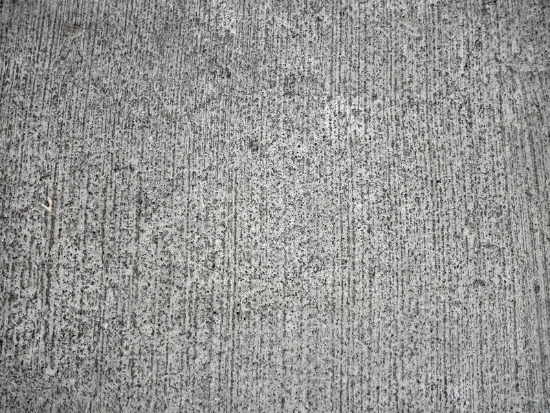 tät väg för cement som textureras upp arkivbilder