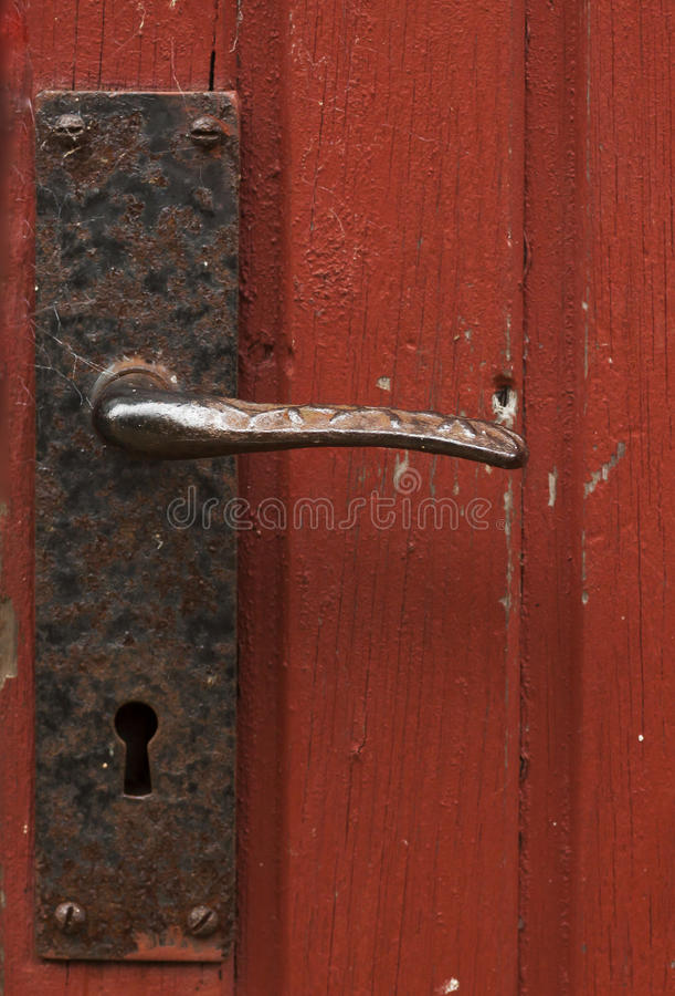 tätt dörrhandtag som skjutas upp arkivbilder