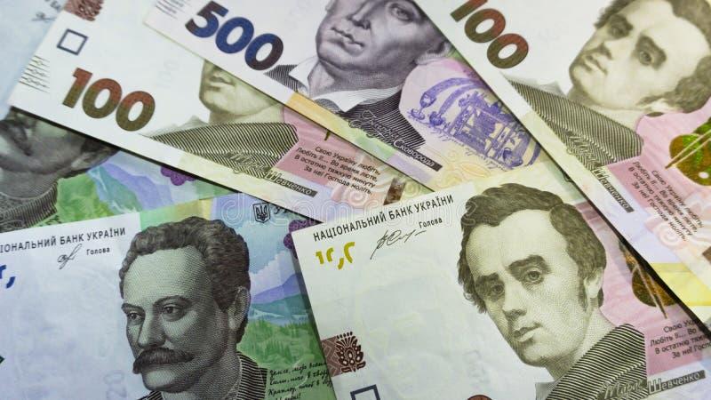 Tätt tävla upp av ukrainska pengar 100, grivnia 500 för design och idérika projekt arkivbilder
