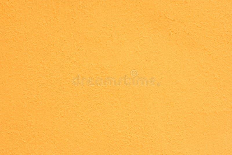 Tło żółty stiuk pokrywał i malował powierzchowność, szorstką obsadę cement i betonowej ściany teksturę zdjęcie royalty free