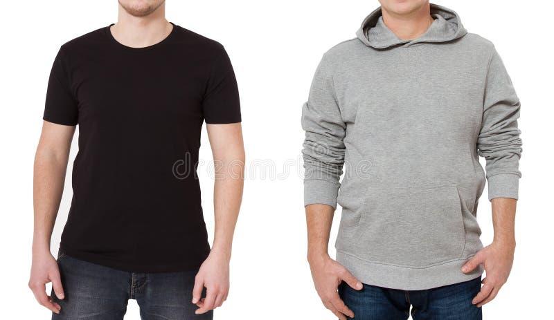T恤杉和运动衫模板 人黑T恤杉的和灰色hoody的 正面图 在白色背景隔绝的嘲笑 复制 免版税库存图片