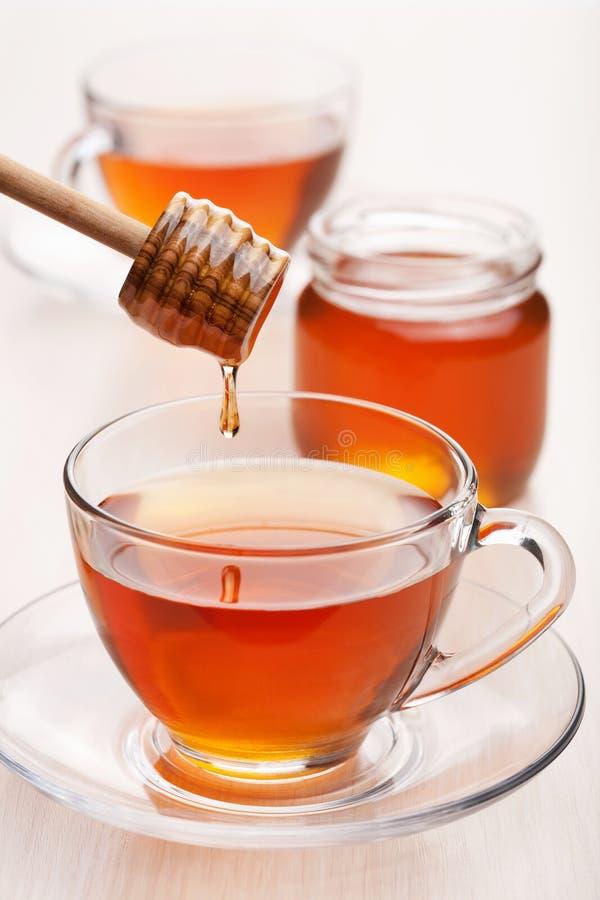Tè con miele immagini stock libere da diritti
