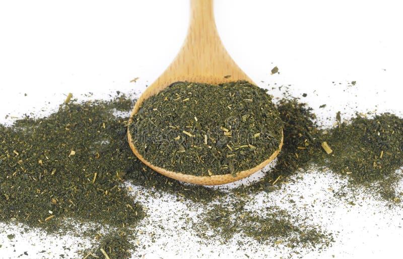 Tè in cucchiaio di legno fotografia stock libera da diritti