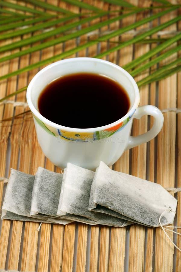 Tè e bustine di tè fotografia stock libera da diritti