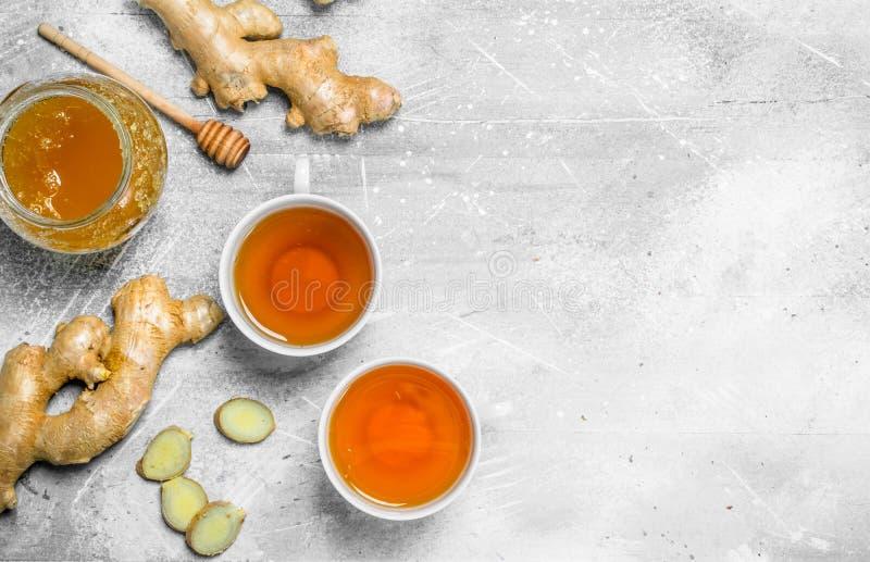 Tè e miele dello zenzero fotografia stock libera da diritti