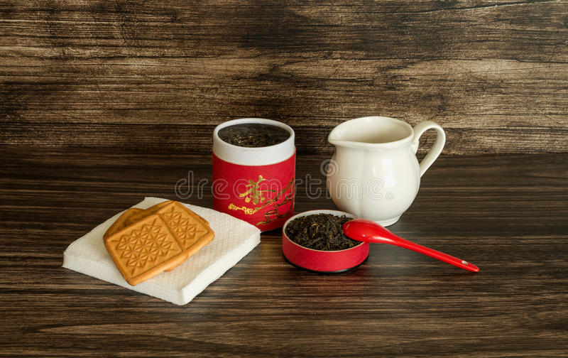 Té, galletas y un tarro fotos de archivo libres de regalías