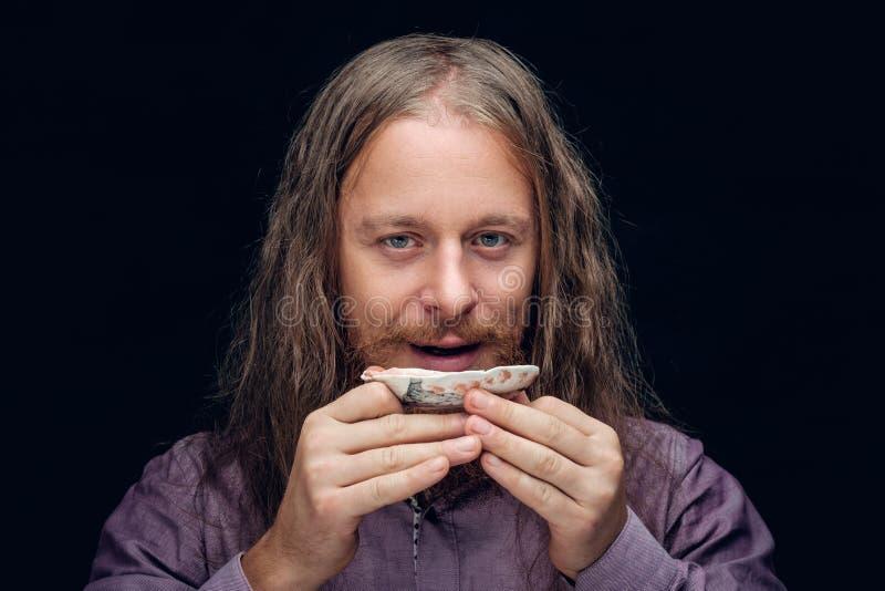 Té masculino barbudo positivo de la prueba fotografía de archivo libre de regalías