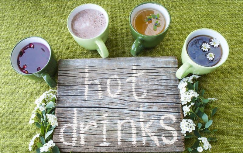 Té negro, verde y de la fruta, bebidas calientes, café, cacao imagen de archivo